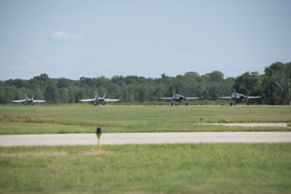132nd Electronic Attack Squadron EA-18 Growlers and 33rd Fighter Wing F-35As taxi down the flightline during Northern Lightning Aug. 22, 2016, at Volk Field, Wis. (U.S. Air Force photo by Senior Airman Stormy Archer)