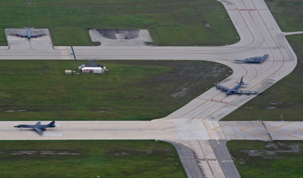 A U.S. Air Force B-52 Stratofortress, B-1 Lancer and B-2 Spirit taxi in preparation for an integrated bomber mission at Andersen Air Force Base, Guam, Aug.17, 2016. This mission marks the first time in history that all three of Air Force Global Strike Command's strategic bomber aircraft are simultaneously conducting integrated operations in the U.S. Pacific Command area of operations. As of Aug. 15, the B-1 Lancer will be temporarily deployed to Guam in support of U.S. Pacific Command's Continuous Bomber Presence mission. (U.S. Air Force photo by Senior Airman Joshua Smoot)