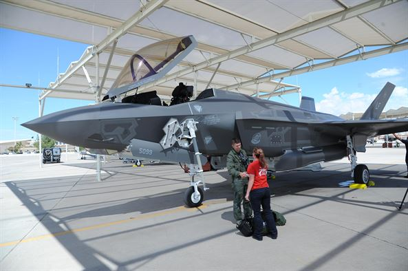Maj.Matt Strongin, 62nd Fighter Squadron F-35 Lightning II pilot, is met by a 62nd Aircraft Maintenance Unit Airman Aug. 26, 2016, after landing the Air Force's 100th F-35. This milestone comes on the heels of the Air Force's announcement of the F-35's initial operational capability. (U.S. Air Force photo by Tech. Sgt. Luther Mitchell Jr)