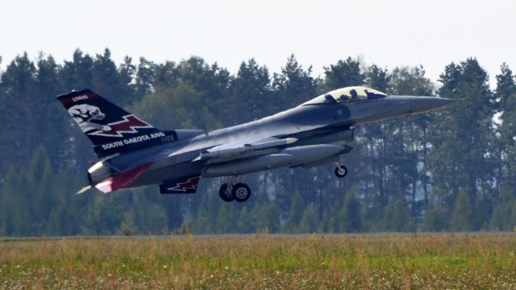 Lask Air Base, Poland -- An F-16 Fighting Falcon from the South Dakota Air National Guard 114th Fighter Wing lands at Lask Air Base, Sept. 3. More than 100 members of the 114FW are deployed in support of Aviation Detachment 16-4, a bilateral training exercise between the U.S. and Polish forces. (U.S. Air National Guard photo by Capt. Amy Rittberger/Released)