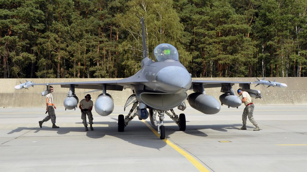 Lask Air Base, Poland -- Members of the South Dakota Air National Guard 114th Maintenance Group immediately begin an initial cursory inspection of an F-16 Fighting Falcon upon arrival here Sept. 3. Additional recovery procedures are then performed after the aircraft is shut down. (U.S. Air National Guard photo by Capt. Amy Rittberger/Released)