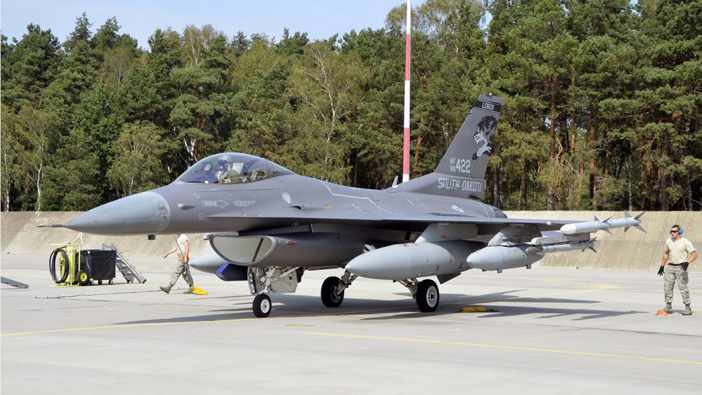 Lask Air Base, Poland -- An F-16 Fighting Falcon from the South Dakota Air National Guard 114th Fighter Wing parks at Lask Air Base, Sept. 3. More than 100 members of the 114FW are deployed in support of Aviation Detachment 16-4, a bilateral training exercise between the U.S. and Polish forces. (U.S. Air National Guard photo by Capt. Amy Rittberger/Released)